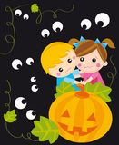 Halloween night. Illustration of children scared behind the pumpkin with eyes arround Stock Photos