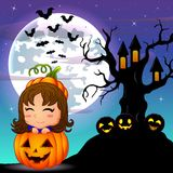 Halloween night background with cute little girl in basket pumpkin and scary tree house Royalty Free Stock Image