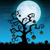 Halloween night background with hanging pumpkin on dry tree in graveyard Stock Image