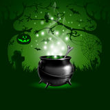Halloween. Night background with with magic potion in a cauldron Stock Images