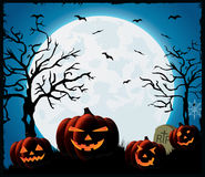Halloween night background. Pumpkin on blue Moon background Royalty Free Stock Images