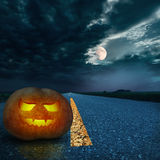 Halloween night background on the road Stock Image