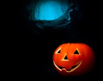 Halloween night background with scary dark tomb background and pumpkin Royalty Free Stock Photo