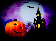 Halloween night background with scary house and bat and pumpkin Royalty Free Stock Photos