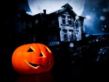 Halloween night background with scary house and bat and pumpkin Royalty Free Stock Image