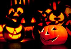 Halloween night background with scary pumpkins in background. Halloween party concept Stock Image