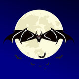 Halloween night with bats flying over moon.  Stock Photo