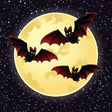 Halloween night with bats flying over moon. Stock Photos