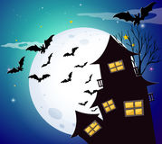 Halloween night with bats and haunted house Stock Images