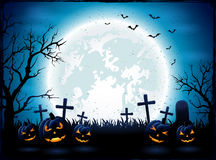 Halloween night with blue Moon and pumpkins Royalty Free Stock Image