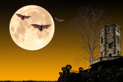 Halloween night concept. Halloween night,old castle and dead tree with bat flying on the moon background,useful for some Halloween concept Stock Photo