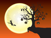 Halloween night. Dead tree decorated with Jack o lanterns and bats on the edge of a cliff Royalty Free Stock Images