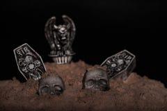 Halloween Night Scene. Halloween night graveyard scene with tombstones, skulls and gargoyles royalty free stock image