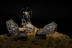 Halloween Night Scene. Halloween night graveyard scene with tombstones, skulls and gargoyles stock photos