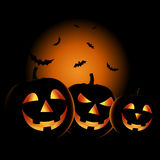 Halloween night with grinning pumpkins background Royalty Free Stock Image