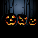 Halloween night with grinning pumpkins in a haunted woods Royalty Free Stock Image