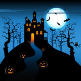 Halloween night with haunted castle and pumpkins Royalty Free Stock Photo