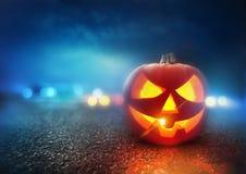 Halloween Night. A Jack O Lantern Pumpkin glowing orange on Halloween evening Stock Images