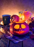 Halloween night pumpkin Jack lantern. Preparing to celebration of Halloween night, carved out of a pumpkin Jack`s lantern with a candle inside stock images