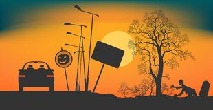 Halloween Night on the road. The car stopped on the road at night. Road signs Halloween. Bushes and a tree without leaves on a roadside. The zombie creeps out Stock Image