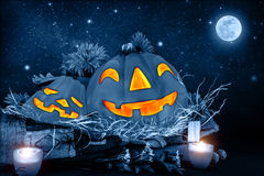 Halloween night. Scary carved pumpkin head glowing in dark starry night, full moon, traditional october holiday, horror concept vector illustration
