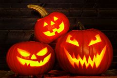 Halloween night scene with Jack o Lanterns against wood Royalty Free Stock Photography