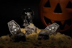 Halloween Night Scene. With Jack O Lanterns, tombstones, skulls and gargoyles royalty free stock photo
