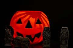 Halloween Night Scene. With Jack O Lanterns, tombstones, skulls and gargoyles stock photo