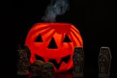 Halloween Night Scene. With Jack O Lanterns, smoke, tombstones, skulls and gargoyles royalty free stock images