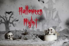 Halloween Night. Skull on an old used thick candle. Scary Hallow. Skull on an old used thick candle. Scary Halloween background. Closeup stock photography