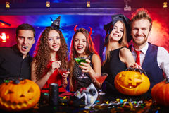 Halloween at nightclub. Friends drinking during Halloween night royalty free stock photography