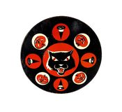 Halloween Noisemaker. Vintage tin Halloween ratchet noisemaker from the 1950s or 1960s. White background Stock Photos