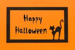 Halloween od tła blasku księżyca uwagi Czarny papierowy kota tekst Szczęśliwy Halloween w czerni ramie na pomarańczowym tle zdjęcia royalty free