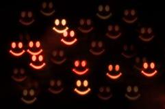 Halloween od tła blasku księżyca uwagi Uśmiechnięte straszne duch twarze w zmroku pojęcie kalendarzowej daty Halloween gospodarst Fotografia Stock