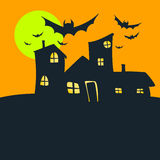 Halloween old house orange sky and moon Stock Photos