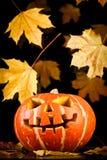 Halloween, old jack-o-lantern on black Royalty Free Stock Photos