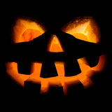 Halloween, old jack-o-lantern on black Royalty Free Stock Photography
