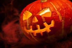 Halloween, old jack-o-lantern on black Royalty Free Stock Image