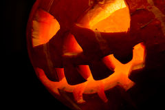 Halloween, old jack-o-lantern on black Stock Photos