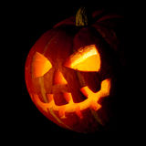 Halloween, old jack-o-lantern on black Royalty Free Stock Photo
