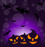 Halloween ominous pumpkins on moonlight background Stock Photos