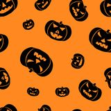 Halloween orange background with angry faces pumpkins silhouettes festive seamless pattern. Endless background. Stock Images