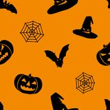 Halloween orange background with black witch hat, bats, web and pumpkins silhouettes festive seamless pattern. Royalty Free Stock Images