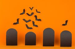 Halloween orange background with blank black sale labels and bats flock, mock up. Template for advertising, design, cover royalty free stock photography