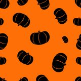 Halloween orange background with pumpkins silhouettes festive seamless pattern. Endless background. Royalty Free Stock Photography