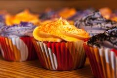 Halloween Orange and Black Cupcakes Stock Photos