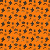 Halloween orange festive seamless pattern. Endless background wi. Th pumpkins, skulls, bats, spiders, ghosts, bones, candies, spider web. For web design and Stock Photography