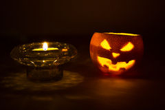 Halloween orange fruit jack  lantern with candle on dark Stock Photo