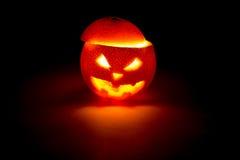 Halloween orange fruit jack  lantern on dark Royalty Free Stock Photo
