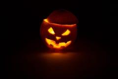 Halloween orange fruit jack  lantern on dark Stock Images
